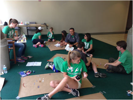 Campers and volunteers creating customized descriptions of what stuttering means to them