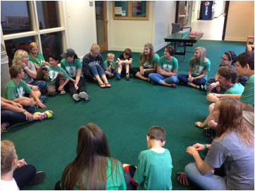 Campers and volunteers having fun playing group games