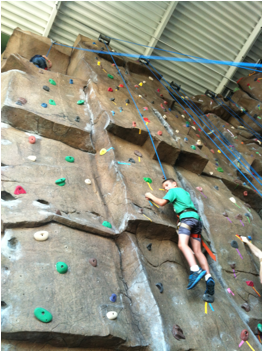 Campers climbing the 37 ft. rock wall
